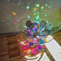 Crystallized light • moving through prisms & fractals • creating a world of holographic rainbows ✨ Obsessed with this amazing rainbow sparkle coffee table created by @jfostermpls ✨