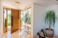 Hall de entrada projetado por Jannini & Sagarra Arquitetura.