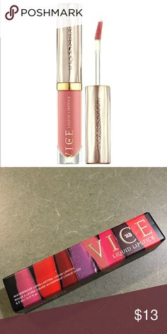 Urban Decay Vice Liquid Lipstick in Trap Queen Urban Decay liquid lipstick -Trap Queen - this is a metallic bright red with gold shimmer.                  This is waterproof formula so life-proof, it's not going ANYWHERE until you take it off. (Just imagine the possibilities.) What makes Vice different? Our high-tech formula provides longer-lasting wear with ZERO transfer. Like our original formula, Vice Liquid Lipstick lays down intensely pigmented color. And the comfortable, nondrying wear…