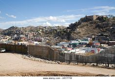 Nogales Arizona A section of the border fence that separates the United States in the foreground from Mexico - Stock Image