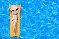 Woman Floating On A Pool Mattress