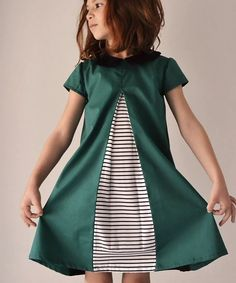 The Eleena dress is a 1960s inspired A-line dress that features an inverted pleat and an invisible zipper in the back. There are three sleeve options to choose from - short set in sleeves, long sleeves with cuffs and flutter sleeves. The unique collar completes the look.