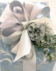 Ahhhh...damask paper, silver silky ribbon, and sprayed silver adorments....perfection