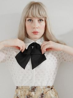 giant black bow to liven up a blouse