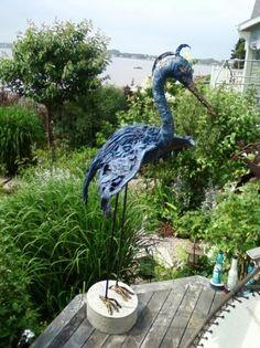 large winged blue heron
