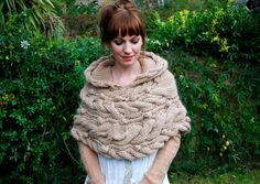 want this... but I want it be longer, cape length... and I need someone else to knit it for me. Crap.