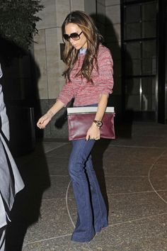 Victoria Beckham looking casual sweater jeans l R