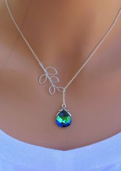 Pretty . . . Peacock, Aqua Sphinx and Branch sterling silver Swarovski Briolette necklace. $32 on Etsy.