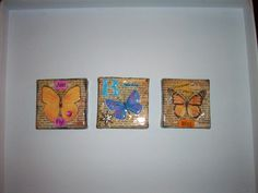 My mini butterfly/dictionary page collages embossed with Utee. Only an inch and a half square:)