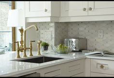 Use picture frame fillet to give shaker-style cabinets an elegant touch.So clever! Also love the backsplash and faucet.