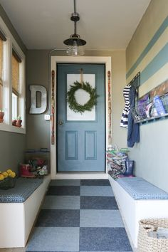 A mudroom for the whole family.  A place for coats, hats, and even dripping boots. #TriplePFeature www.thedempsterlogbook.com