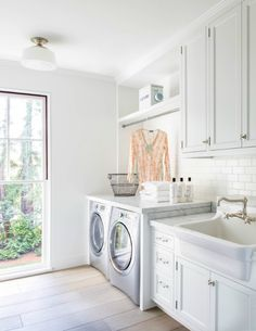 laundry rooms need great light like this!  love the floors, too.