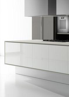 Doca kitchens: I like the way the granite counter top wraps around the island