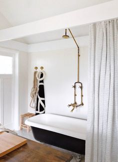 whitewashed bathroom with industrial chic fixtures, painted clawfoot tub and wood vanity. vintage sfgirlbybay / bohemian modern style from a san francisco girl This Old House, Sell My House, Clawfoot Tub Bathroom, Small Bathroom, Vanity Bathroom, Rental Bathroom, Master Bathroom, Girl Bathrooms, Dream Bathrooms