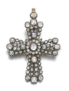 Diamond brooch, circa 1800. Designed as a Latin cross set with oval, old mine, pear- and cushion-shaped diamonds in a closed back setting, later fittings.