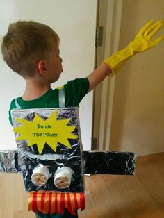 Kids jet pack  Easy kids super hero outfit.   Use an old cereal box and cover in tin foil. Use some cardboard for wings, cover in foil and stick on. Use some ribbon for straps. Tissue paper or ribbon for flames and add what ever decoration you want. For full effect dress child all in one colour and get a pair of washing up gloves to complete the look