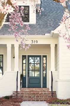Front door is Yorktowne Green & exterior paint is White Dove both by Benjamin Moore exterior Small Modern Farmhouse with Front Porch House Front Door, Exterior Paint Colors For House, Farmhouse Exterior, Paint Colors For Home, House Front, Painted Front Doors, Exterior Brick, Exterior Doors, Exterior Trim