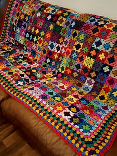 A gorgeous granny square blanket all crocheted together with fabulous tiny mini granny squares - colourful yarn and bordered in various bright, vivid happy colours. Perfect for bed or sofa and ver.Striking Mini Granny Squares Blanket Afghan 70 x от Granny Square Crochet Pattern, Crochet Squares, Crochet Blanket Patterns, Crochet Granny, Baby Blanket Crochet, Crochet Blocks, Afghan Patterns, Crochet Ideas, Crochet Bedspread