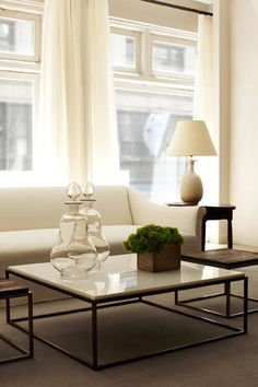 Clean lines and neutral colors make this picture-perfect modern living room feel fresh and young