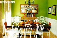 Life as a Thrifter: On Display...DARK TABLE AND WHITE CHAIRS. Love the different shapes!!