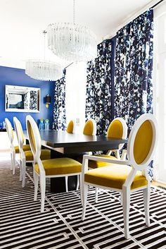 Designer Crush: @catherine gruntman Wong // dining rooms // black and white rugs, crystal chandelier, mustard yellow chairs, abstract fabric