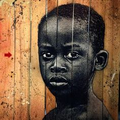 Jef Aerosol, from a photo by Stephane Missier #jefaerosol #stephanemissier #pochoir #stencil #urbanart #blackboy #palissade #wood