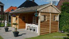 Houten tuinhuis met veranda.  Vechtdal Bouwsystemen BV