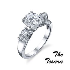 The Tesara  #MR #113-15005    The Tesara - 1.50ct round brilliant cut center diamond with .64cts of round brilliant cut diamonds on the side set in 18kt white gold.http://www.georgethompson.com/engagement-rings/the-tesoro.html#