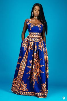 the VICTORIA Maxi $185.00 V neck African print maxi dress with 2 side pockets and back zip