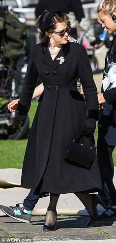 She's got the look! The actress bared an uncanny resemblance to Her Majesty in her elegant frock coat