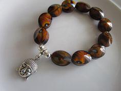 Brown multifaceted oval glass beaded elastic bracelet, silver tone budha charm, yoga budha bracelet, unisex bracelet, yoga bracelet, unisex by LeeliaDesigns on Etsy https://www.etsy.com/listing/257517467/brown-multifaceted-oval-glass-beaded