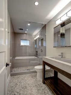 The tub in this Brooklyn, N.Y., guest bathroom is enclosed within a glassed-in shower space, creating a unique bathing area with showstopping style. Description from pinterest.com. I searched for this on bing.com/images