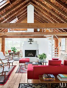 The firm made several augmentations to the property but restored the original barn, which now serves as the living room. It is furnished with midcentury armchairs from Dienst & Dotter Antikviteter, a sectional sofa by Zanotta, and vibrant Navajo rugs.