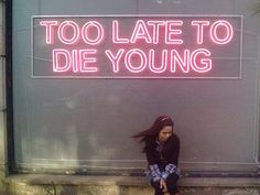 Light up neon signs with cool phrases are the best addition to any room! They add a touch of eighties artist cool.