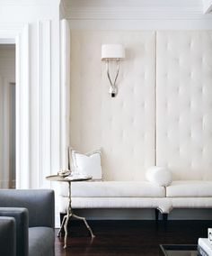 Living room banquette - Custom - Creamy fine-ribbed fabric - how gorgeous (also love the twig side table + sconces)