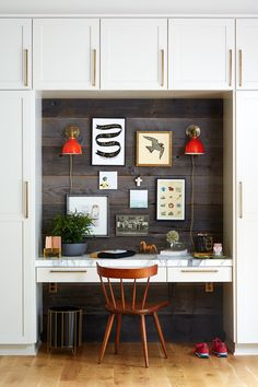 Red sconces & brass pulls are pretty much all the accents we could want--but this office goes above the call of duty w/ a gallery wall, marble, & wood planks!