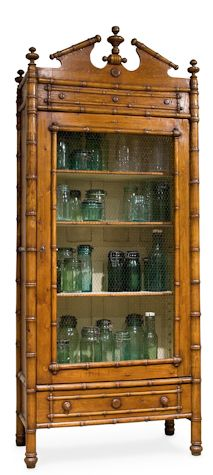 Classic English style faux bamboo Armoire   (I also love the blue glass mason jars inside!)