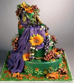 Quite some work in molding fruits and flowers in sugar paste!  Beautiful harvest cake!