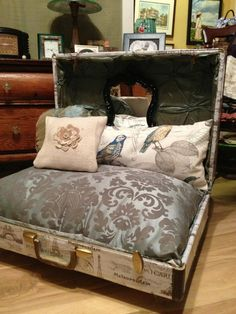 This is a one of a kind and truly beautiful suitcase bed that your pet is sure to love! With elegant and luxurious fabric along with a beautiful black mirror hanging on back. The outside is made with a water resistant rain coat material. The legs are glass door knobs. This Suitcase is 26 inches wide, 19 inches deep and 26 inches tall when its open. Also comes with a matching footstool for you! The stool is 14x16.