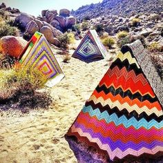 "Artist Léa Donnan created tents made of salvaged crocheted blankets and then scattered them across the Mojave Desert.  The ""Desert Appliqué "" installation was set up last year at the High Desert Test Site.  Fun & colorful :-)"