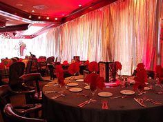 Pipe and drape around the room and red up lighting added to the cool vibe of this Bar Mitzvah decor