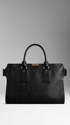 Black Large Signature Grain Leather Tote from Burberry - Refined signature grain leather tote bag.  Top zip closure with oversize zip pull.  Discover the women's bags collection at Burberry.com