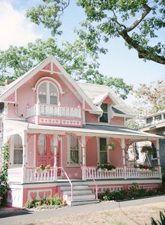 Sweet pink cottage. Would be great for a little girl's playhouse! Oh so cutesy!