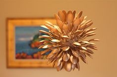 (#DIY Holiday Pinecone Balls) #Upcycle This! 14 Ways to Reuse Plastic Spoons