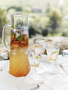 For a refreshing tipple, this plum and basil cooler is as tasty as it looks and can be served neat with ice or mixed with gin or vodka for an elegant cocktail. http://www.hglivingbeautifully.com/2016/07/26/a-summer-lunch-in-provence-wine-cheese/ Recipe Alice Hart, Styling Ali Brown, Photographs Emma Lee.