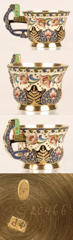 A Russian silver gilt and shaded cloisonne enamel charka, Feodor Ruckert, Moscow, 1896-1908. The shaped body, on a raised flaring base, decorated in stylized multi-color scrolling foliate and geometric motifs against a cream enamel ground, the pierced Pan-Slavic handle similarly worked