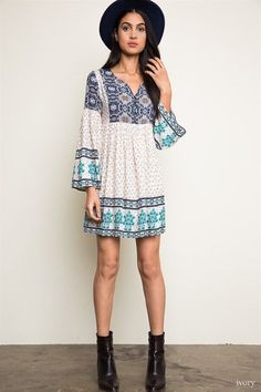 Show off your hippie style in this adorable tunic dress. Flowy, lightweight, and comfortable are three words that describe this dress. The color combination of ivory and blue make for a soft yet boho