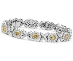 Unique and extraordinary, this floral motif bracelet showcases over 13 carats of diamonds set in 18k yellow and white gold.