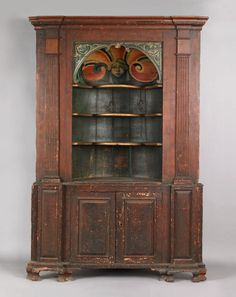 two part corner cupboard, probably English, mid 18th c. with great painted decoration