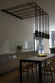 Interesting way for hanging lights above dining table for that industrial look